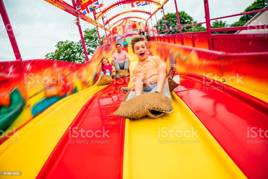 Little boy on Slide at a Funfair stock photo