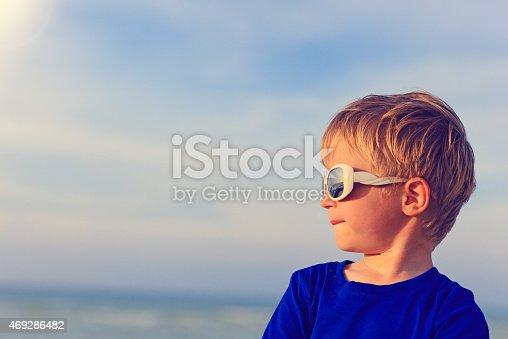 istock little boy on summer sea beach 469286482