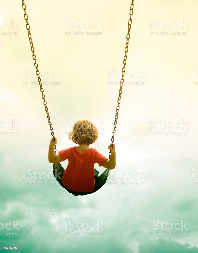 Little Boy On Swing stock photo