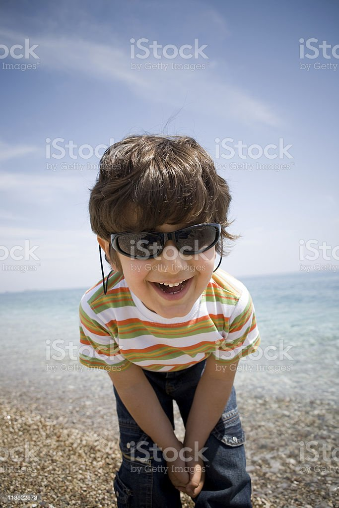 Little boy on the beach royalty-free stock photo