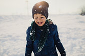 Photo of a little boy enjoys winter activities that snow brings