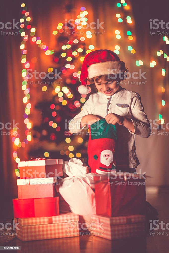 Little boy opening his Christmas gifts zbiór zdjęć royalty-free