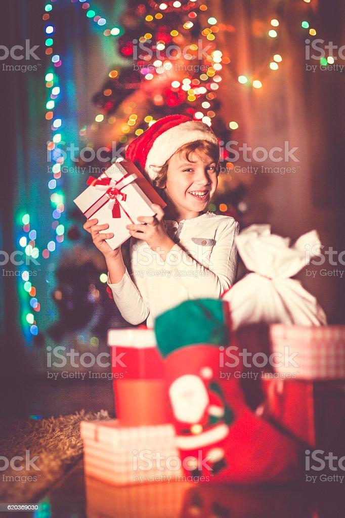 Little boy opening his Christmas gifts zbiór zdjęć royalty-free
