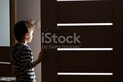 istock Little boy opens the door to the room 504751542