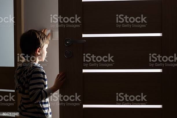 Little boy opens the door to the room picture id504751542?b=1&k=6&m=504751542&s=612x612&h=3xiawxjnw8la2b8tith4ncoeu23xvfihwzi3kyia26w=