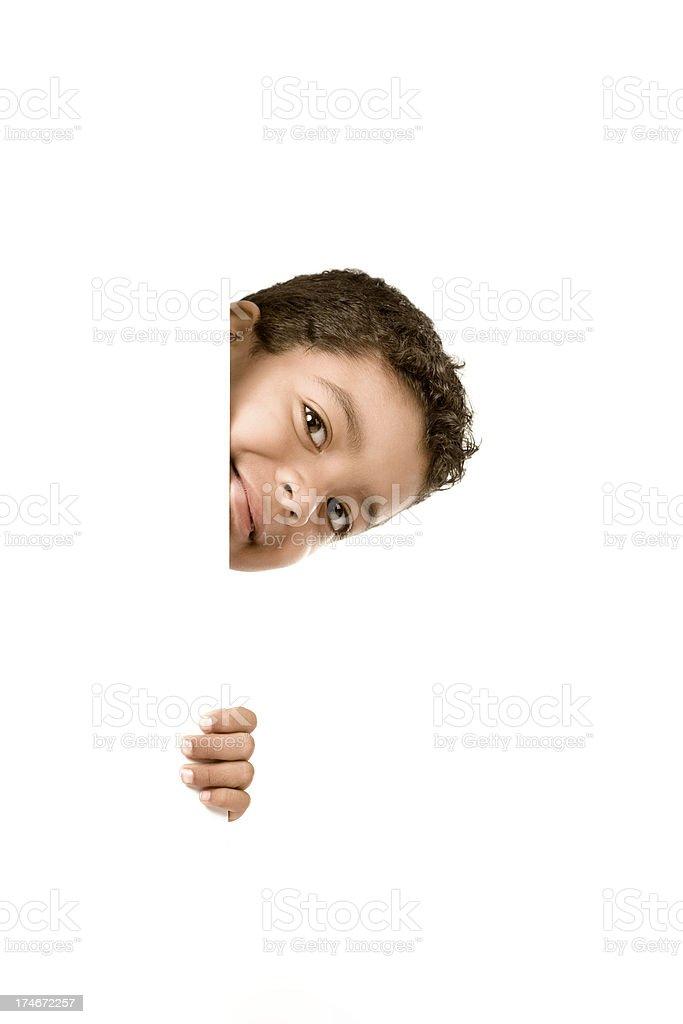 Little boy peeking stock photo