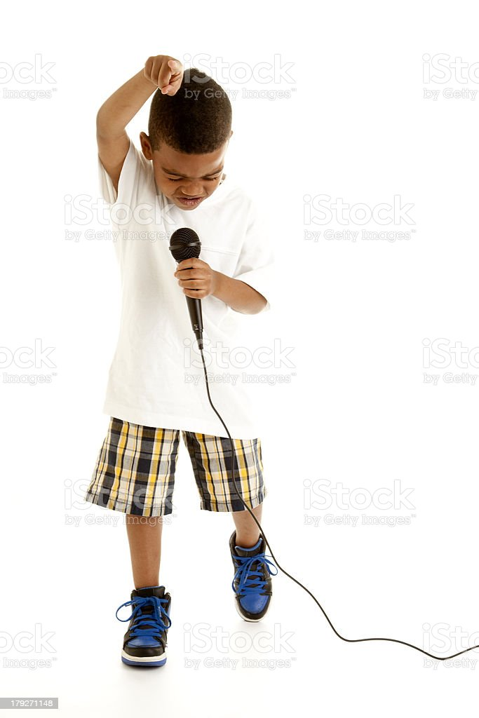 Little Boy Performs a Song with Microphone. royalty-free stock photo