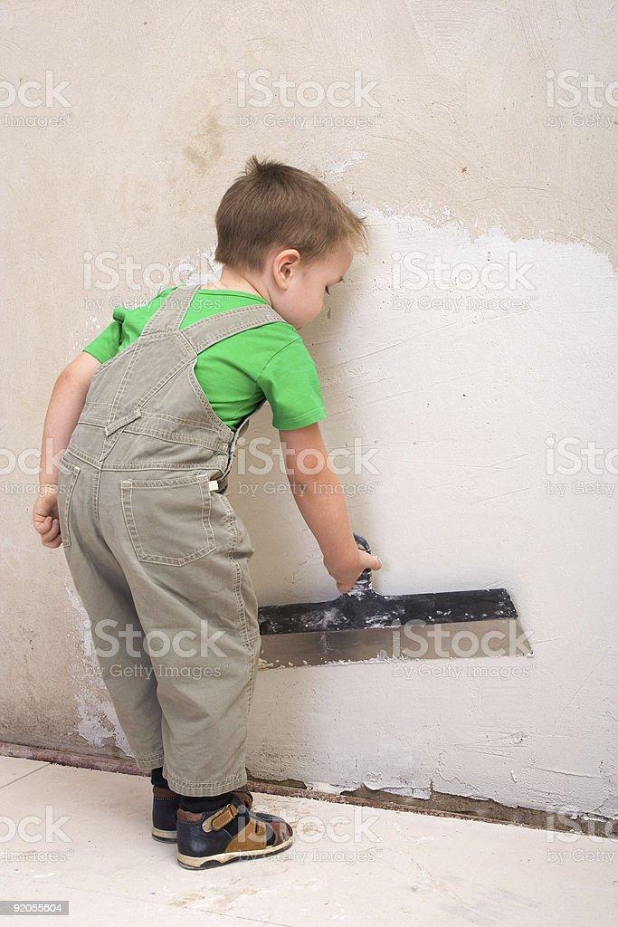 Little boy plasterer royalty-free stock photo