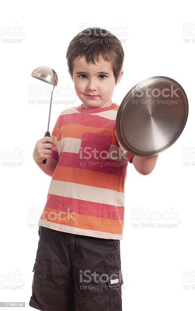 Kleine Junge spielen knight mit Küchenzubehör – Foto