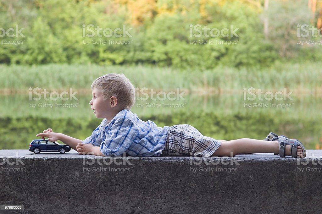 little boy play with a car outdoor royalty-free stock photo