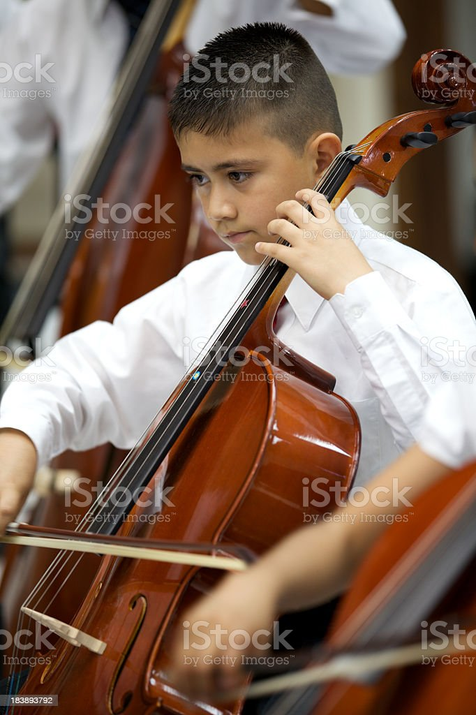 Little boy playing a violin at a classical Music concert stock photo