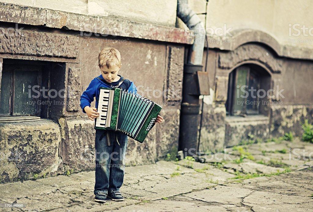 Little boy playing accordion stock photo