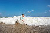 Little boy playing and splashing in sea