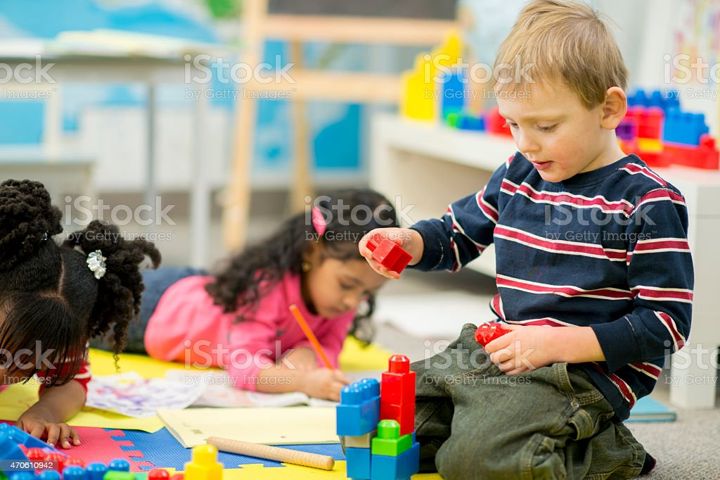 Little Boy Playing at Daycare stock photo