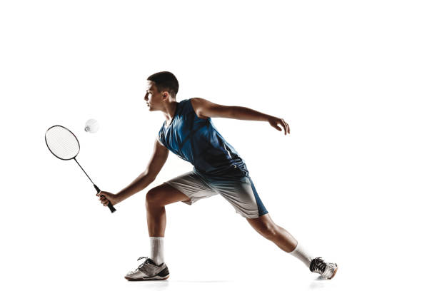 little boy playing badminton isolated on white studio background - badminton sport stock pictures, royalty-free photos & images