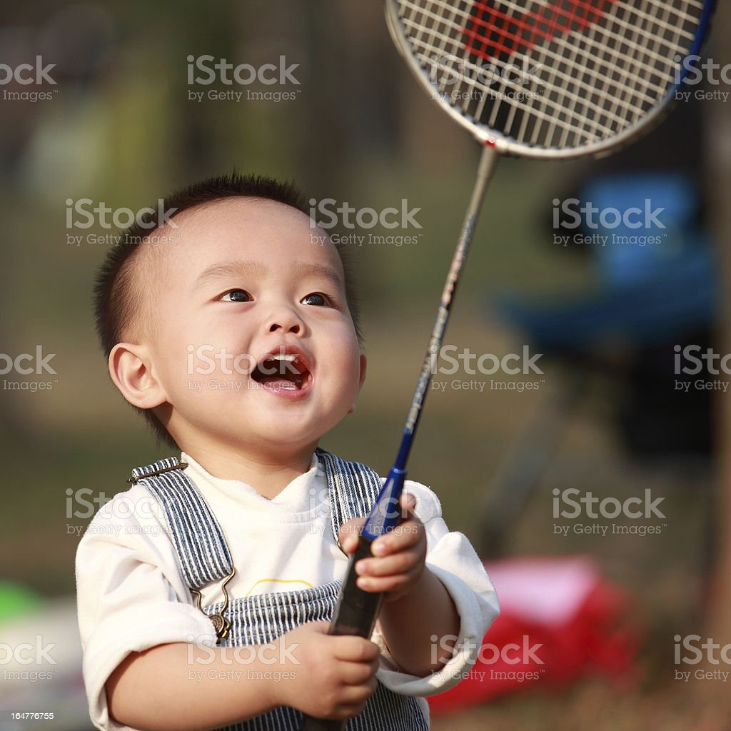 Little boy playing badminton royalty-free stock photo