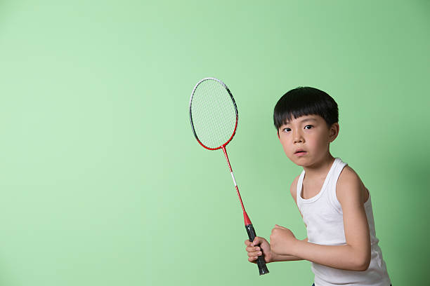 little boy playing badminton - badminton sport stock pictures, royalty-free photos & images