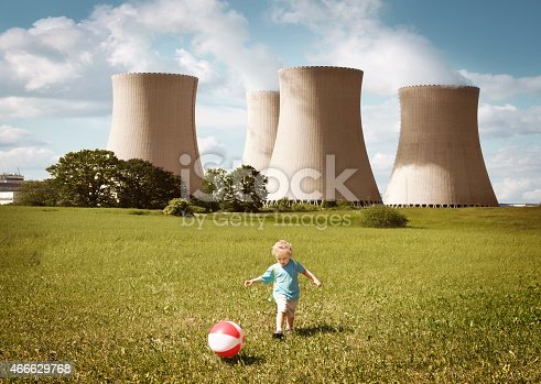 Little boy playing with a ball close to nuclear power plant. See more of this little boy:  http://www.oc-photo.net/FTP/icons/nurvic.jpg