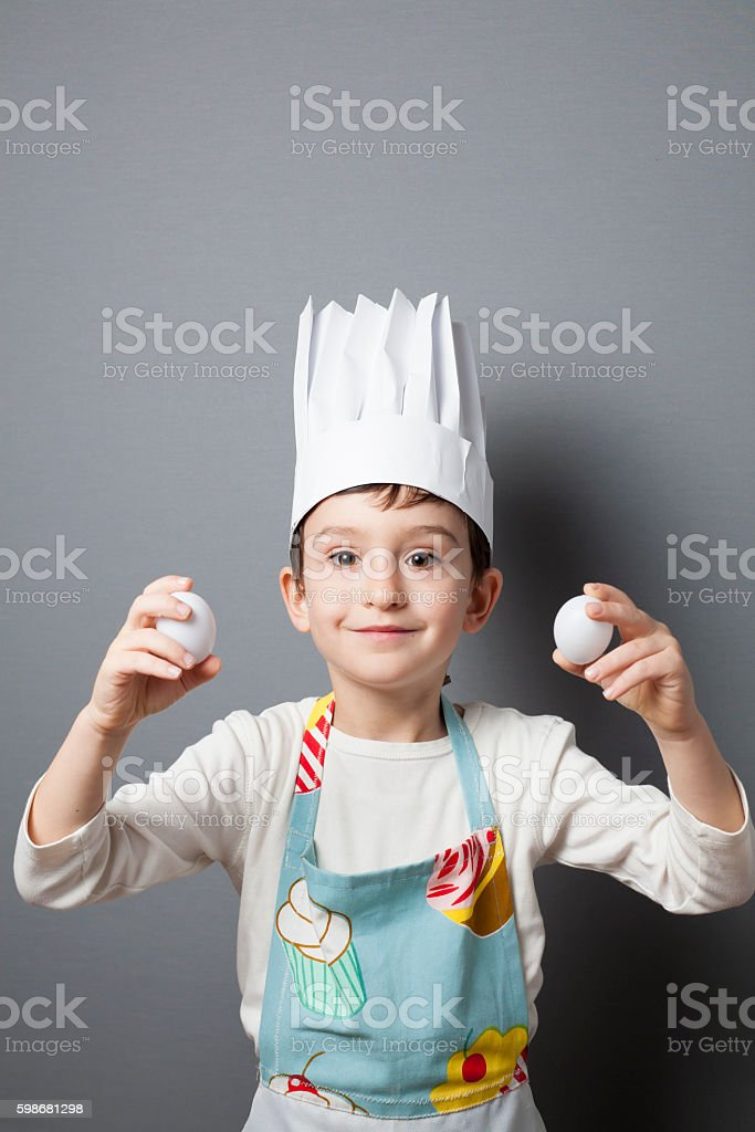 Little boy playing cook stock photo