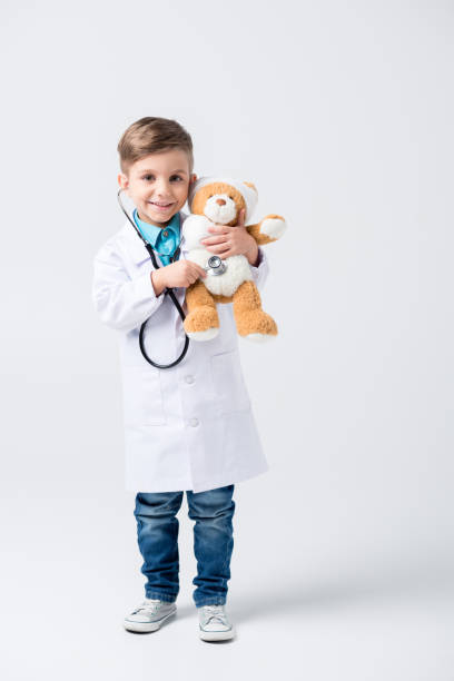 Little boy playing doctor stock photo