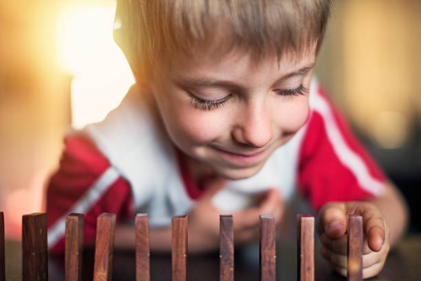 Little boy playing domino stock photo