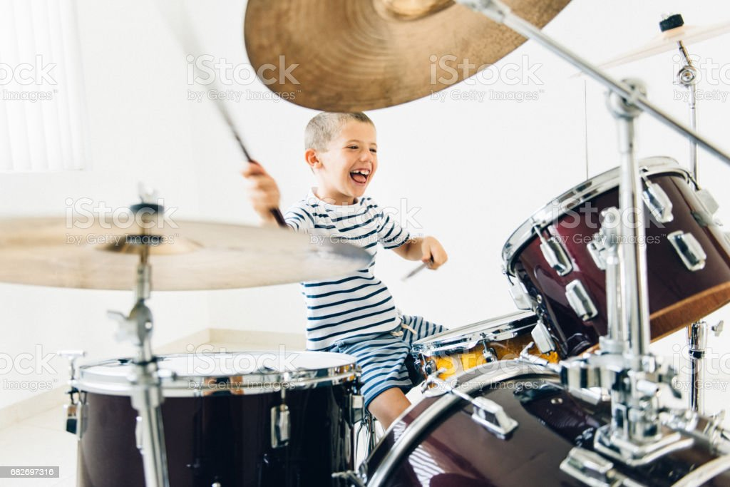 Little boy playing drums stock photo