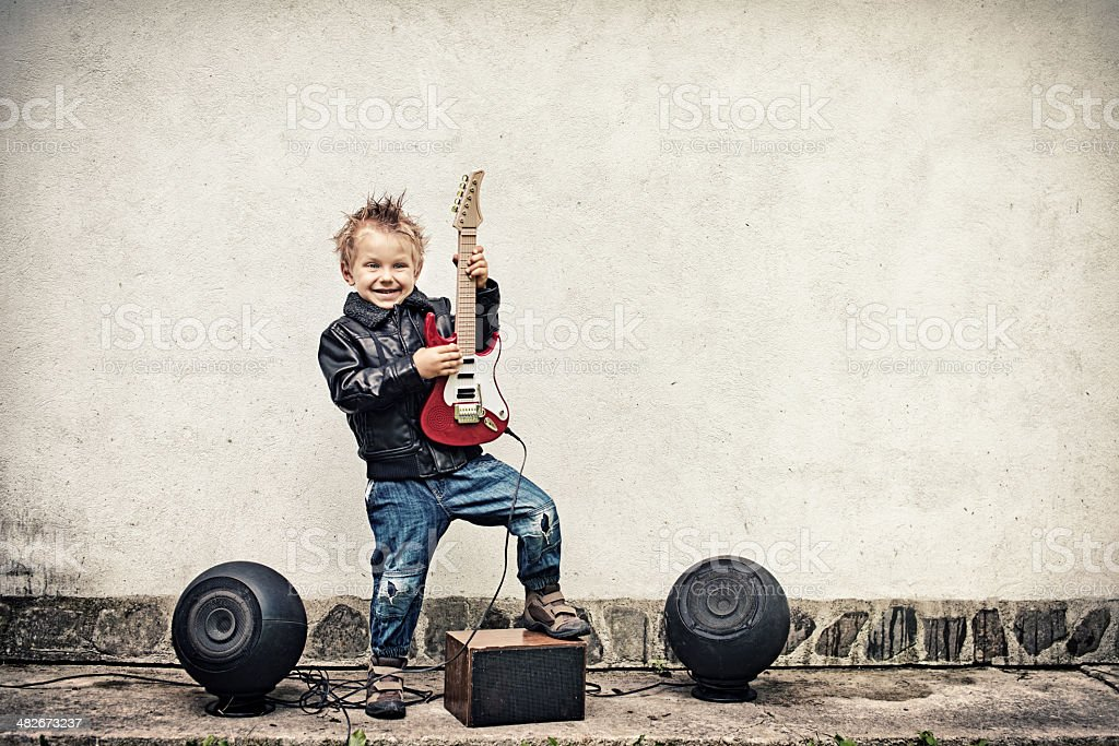Little boy playing electric guitar royalty-free stock photo