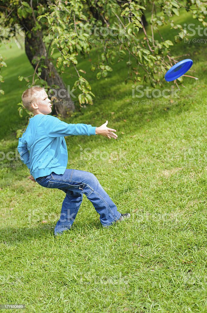 Little boy playing frisbee royalty-free stock photo