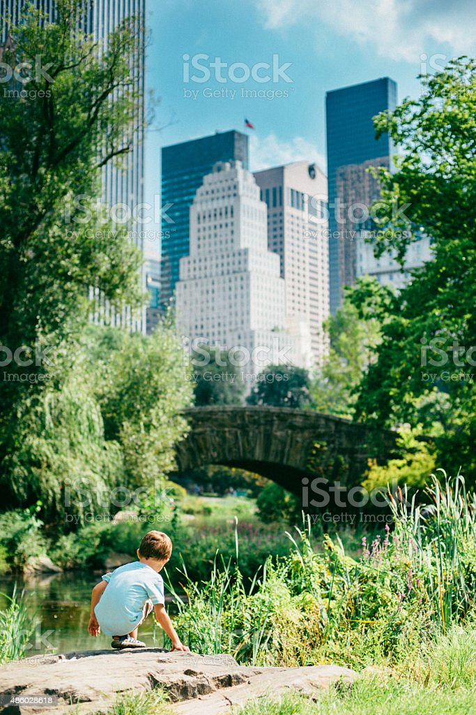 Little boy playing in Central Park New York stock photo