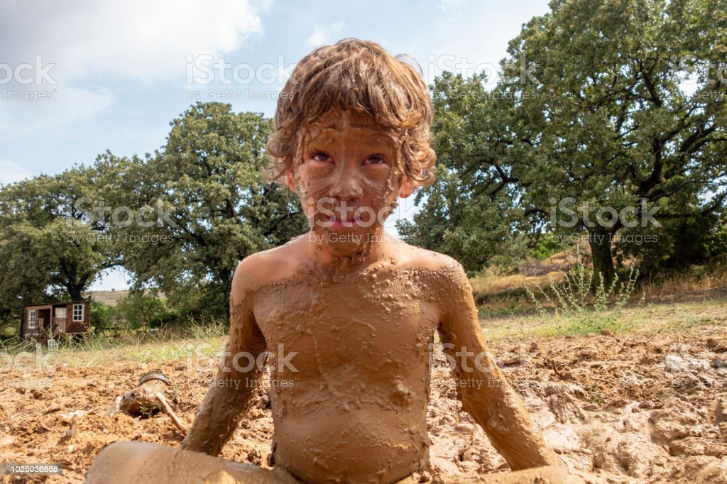 Little Boy Playing In Mud Stock Photo - Download Image Now