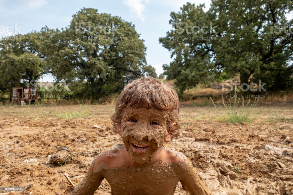 Two Boys Playing In The Mud Stock Photo - Download Image
