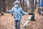Boy wearing a mask and playing outside