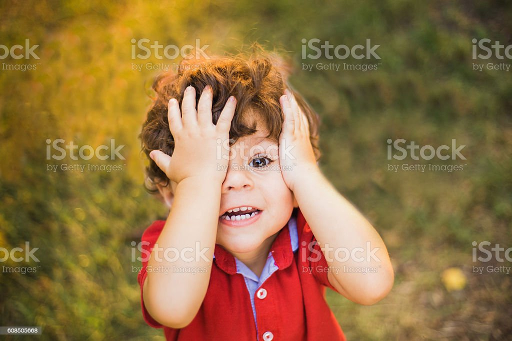 Little boy playing in the park stock photo