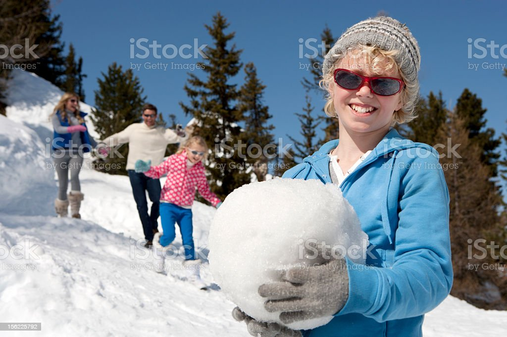 Little boy playing in the snow royalty-free stock photo