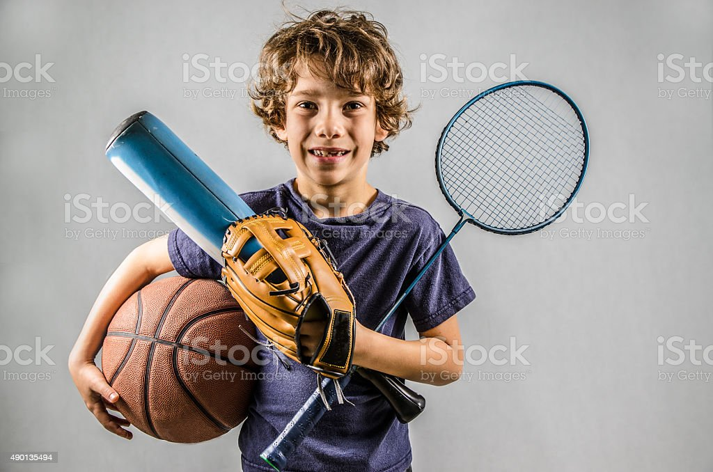 Little boy playing many sports at same time stock photo