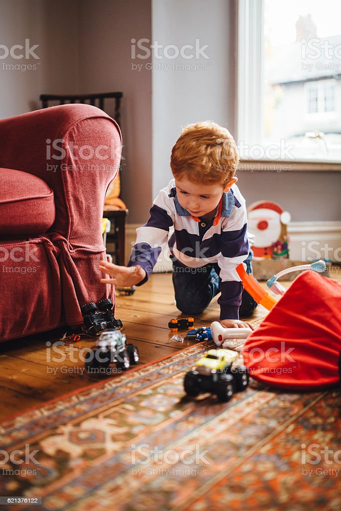 Little Boy Playing on Christmas Day stock photo