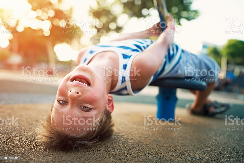 Little boy playing on the playground. stock photo