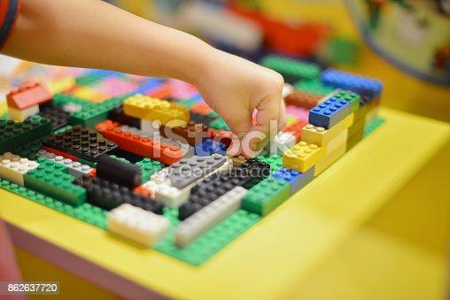 istock Little boy playing plastic blocks construction indoor 862637720