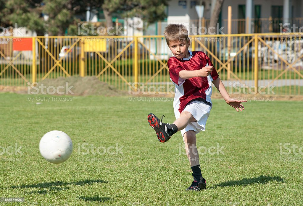 Little Boy playing soccer royalty-free stock photo