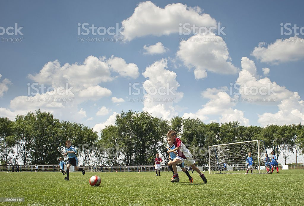 Little Boy playing soccer stock photo