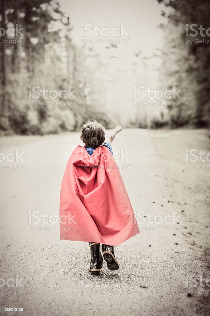 Little boy playing superhero outdoors. Pretend, dress up. royalty-free stock photo