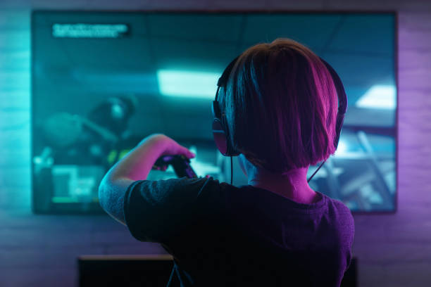 Little boy playing video game stock photo