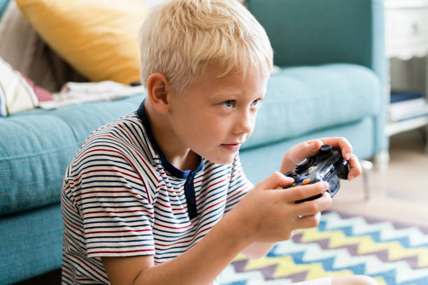 Little boy playing video games stock photo