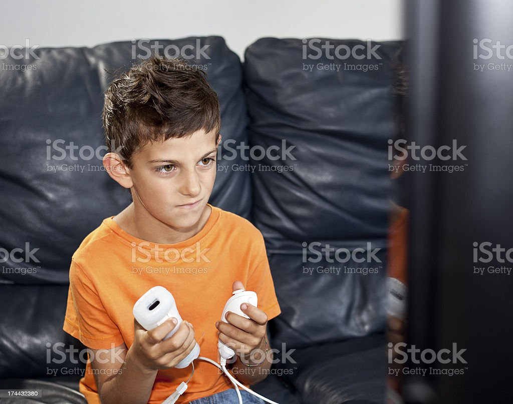 Little Boy Playing Videogame royalty-free stock photo
