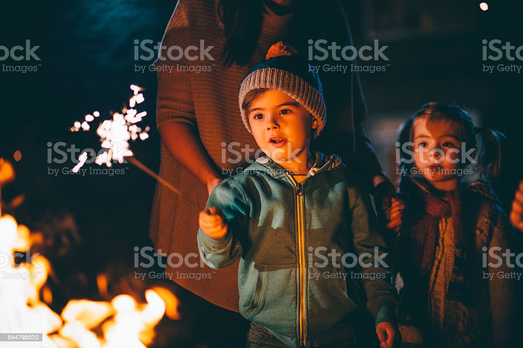 Little Boy Playing With a Sparkler stock photo