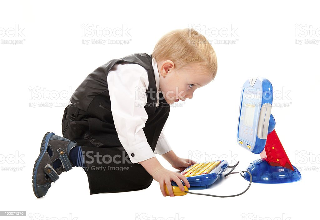 Little boy playing with a toy computer royalty-free stock photo