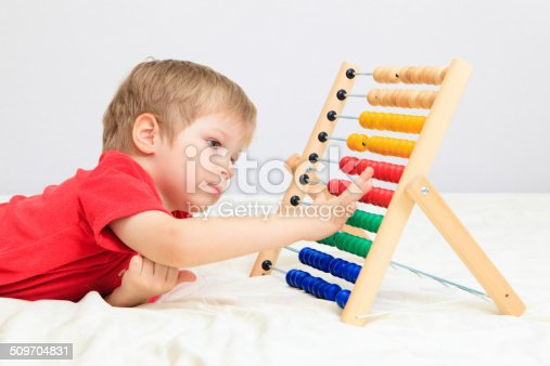 157230867istockphoto little boy playing with abacus 509704831