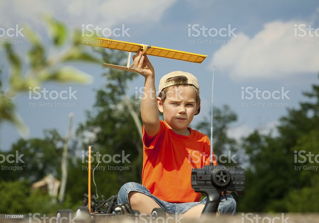 Little boy playing with airplane stock photo