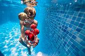 Little boy is having fun swimming in pool during summer Christmas.  Nikon D850