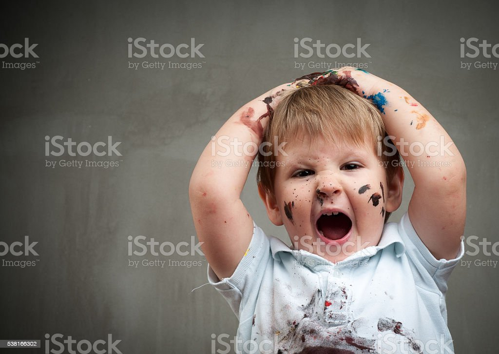Little boy playing with bright colors stock photo